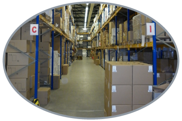 Looking down an aisle of a warehouse with racking on both sides